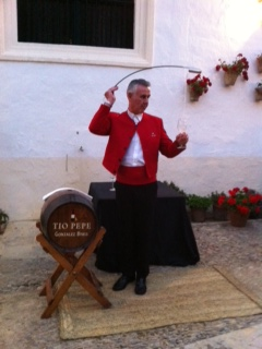 Using A Traditional Sherry Venencia To Pour Fino Wine