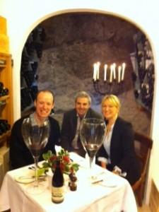 RAchel, Gary and Mike highlighting the Mas de Daumas Gassac Long Table dinner - with some giant glasses for fun, in the wine cellar at Ballymaloe House